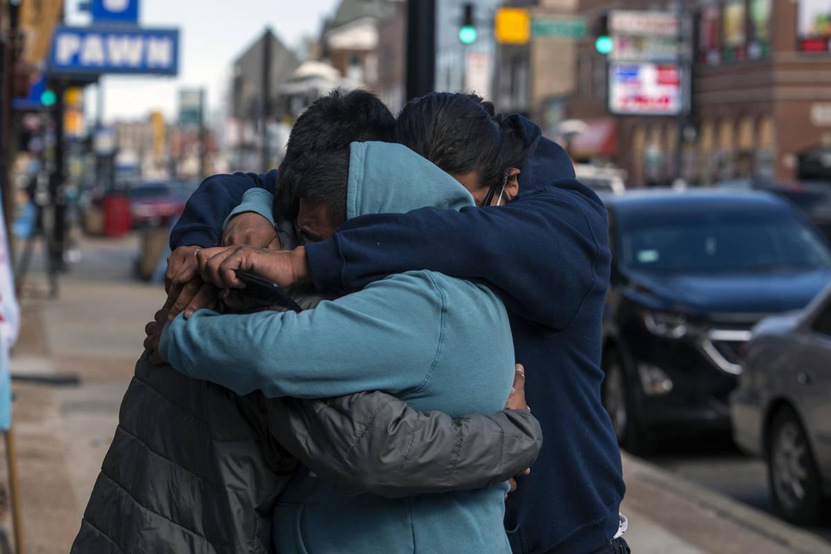 Baltazar Enriquez, Kristian Armendariz, and Enrique Enriquez embrace one another, after the bod ...