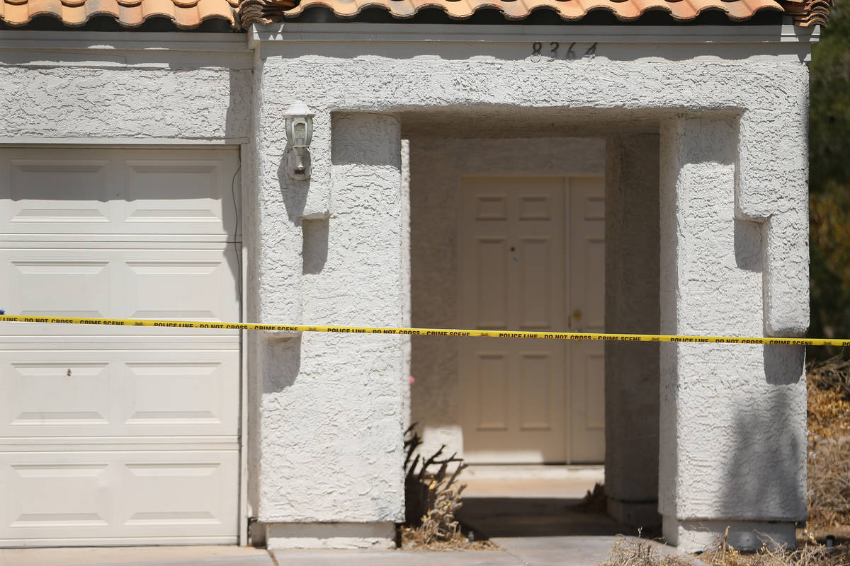 The Las Vegas Metropolitan Police Department investigate the discovery of human remains at a ho ...