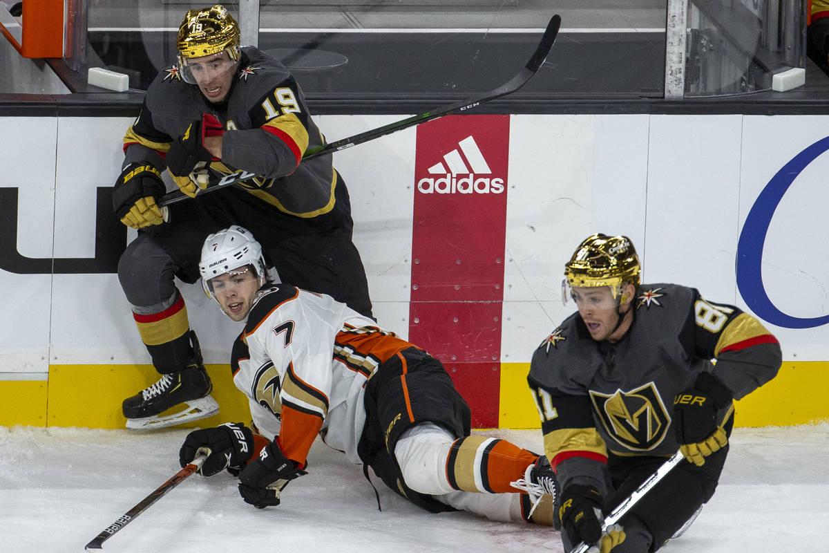 Golden Knights right wing Reilly Smith (19) and Anaheim Ducks defenseman Ben Hutton (7) tangle ...