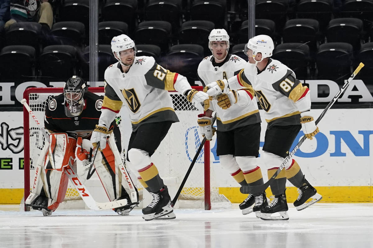 Vegas Golden Knights defenseman Shea Theodore (27), right wing Reilly Smith (19), and center Jo ...