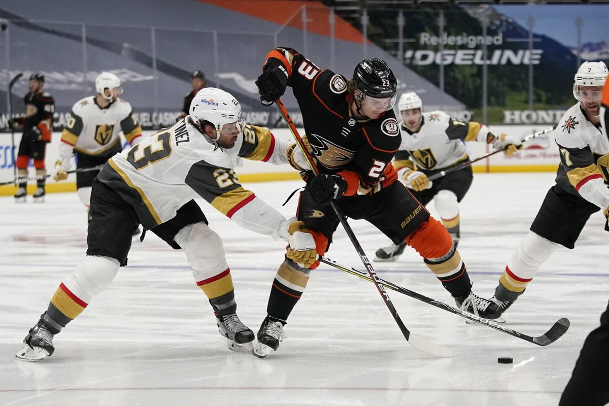 Vegas Golden Knights defenseman Alec Martinez, left, tries to steal the puck from Anaheim Ducks ...