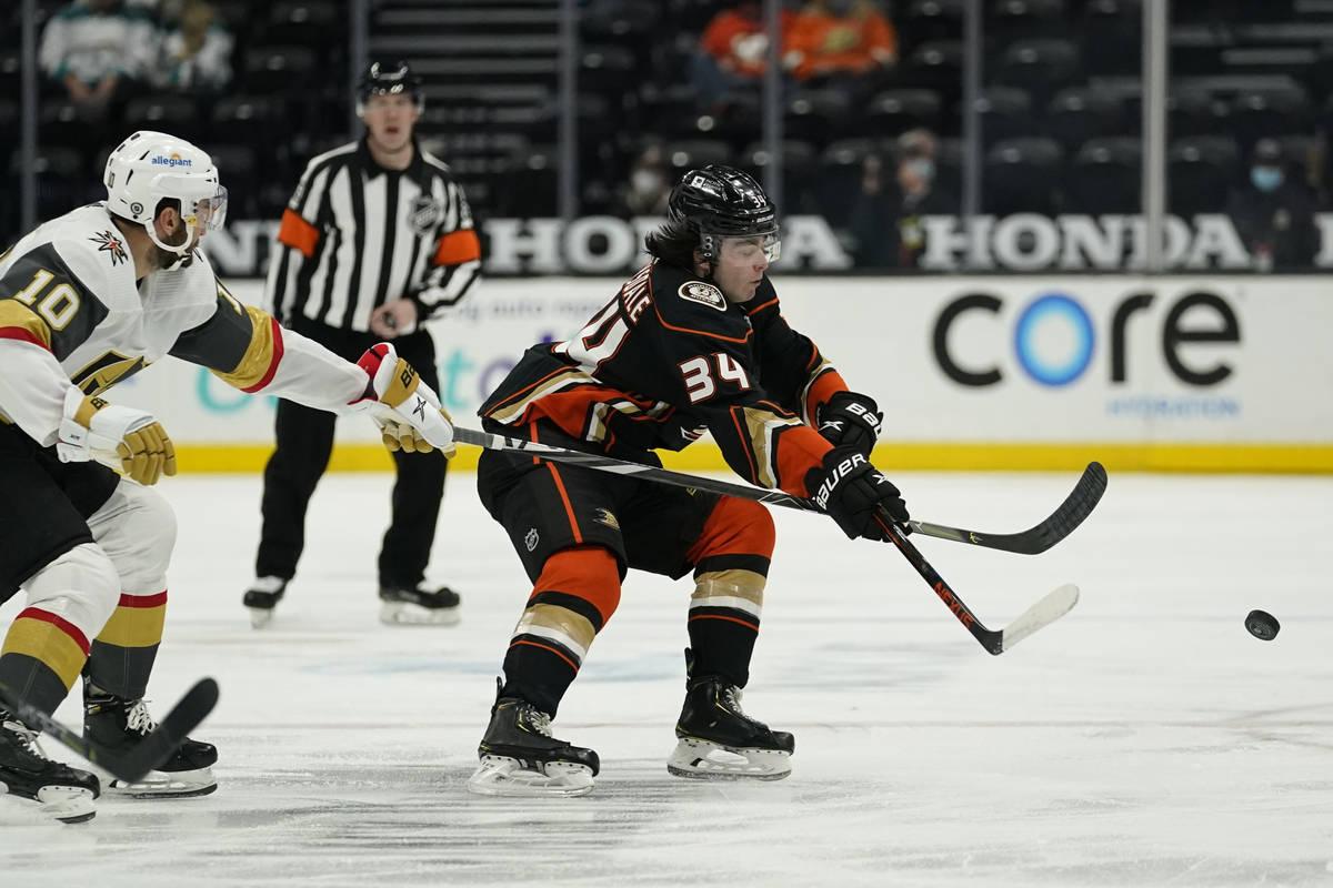 Vegas Golden Knights center Nicolas Roy (10) and Anaheim Ducks defenseman Jamie Drysdale (34) r ...