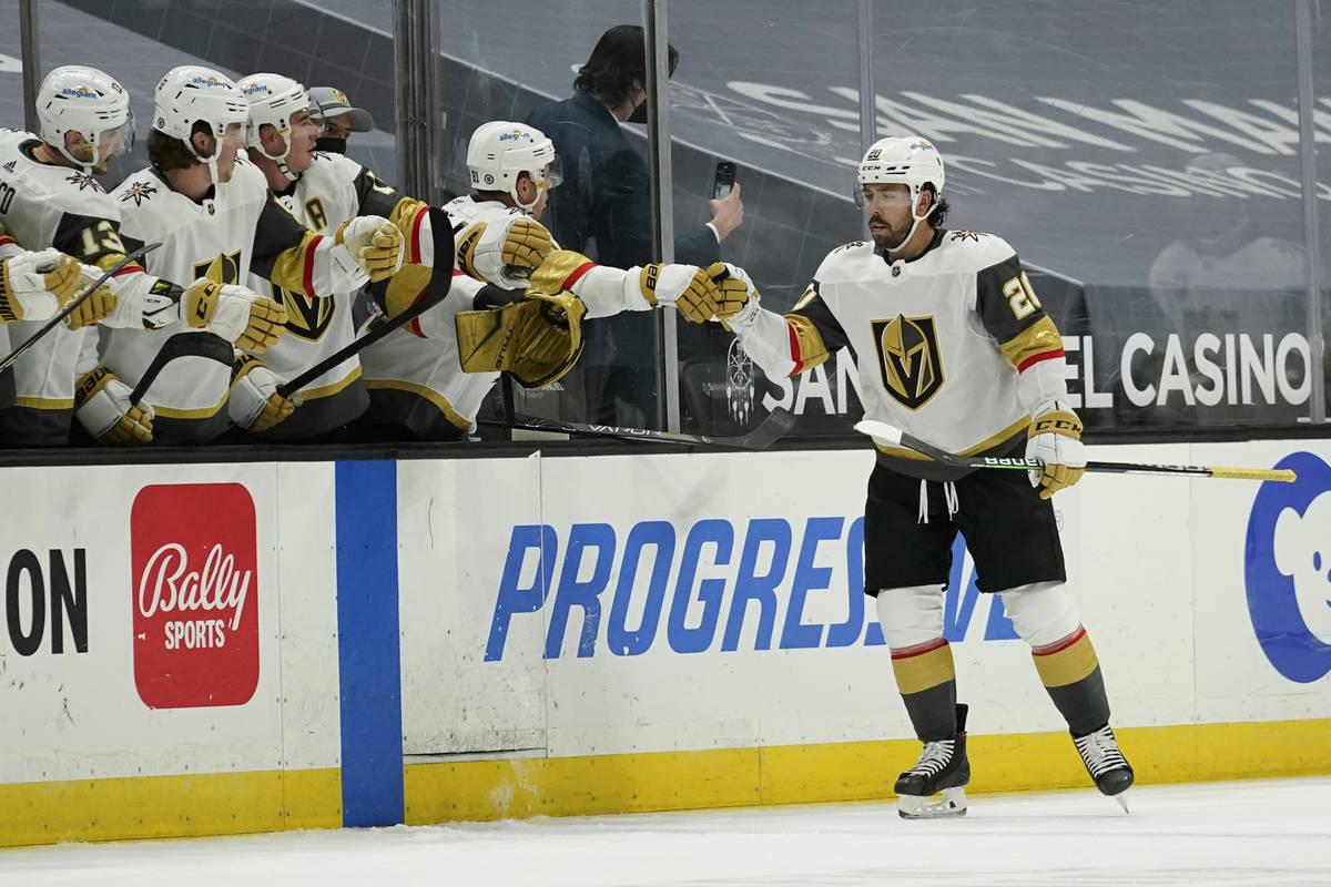 Vegas Golden Knights center Chandler Stephenson (20) celebrates with his teammates after scorin ...