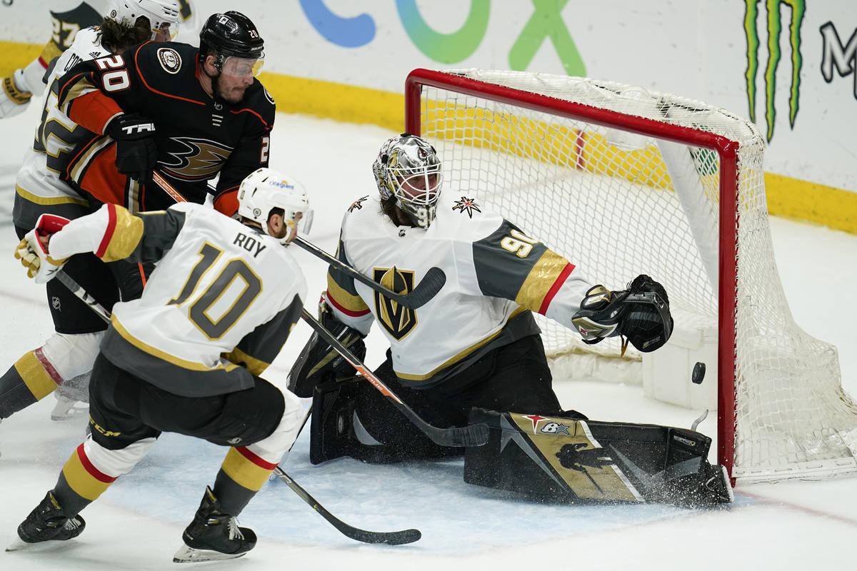 Vegas Golden Knights goaltender Robin Lehner (90) deflects a shot by Anaheim Ducks left wing Ni ...