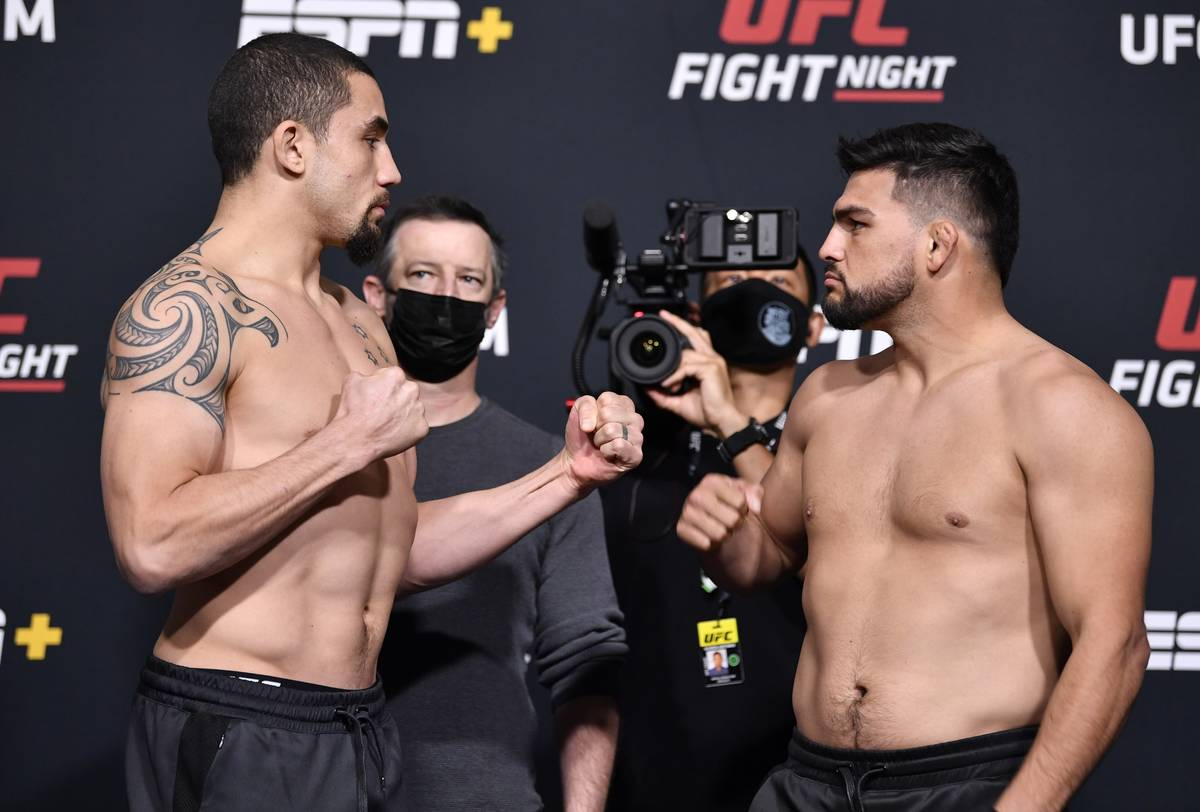 Opponents Robert Whittaker of Australia (left) and Kelvin Gastelum face off during the UFC weig ...