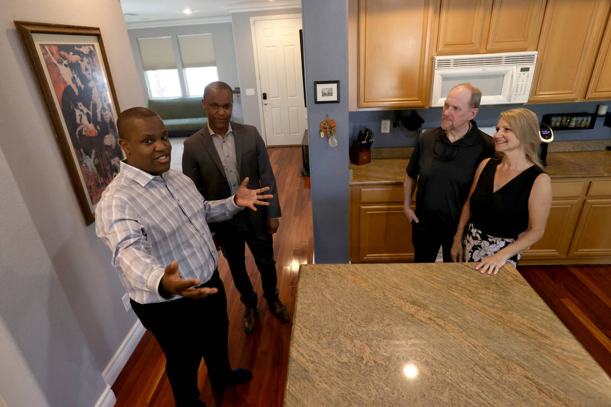 Realtor Shawn Cunningham, left, and his brother Kyle Cunningham, show a Las Vegas house for sal ...