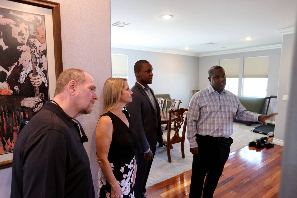 Realtor Shawn Cunningham, right, and his brother Kyle Cunningham, second from right, show a Las ...