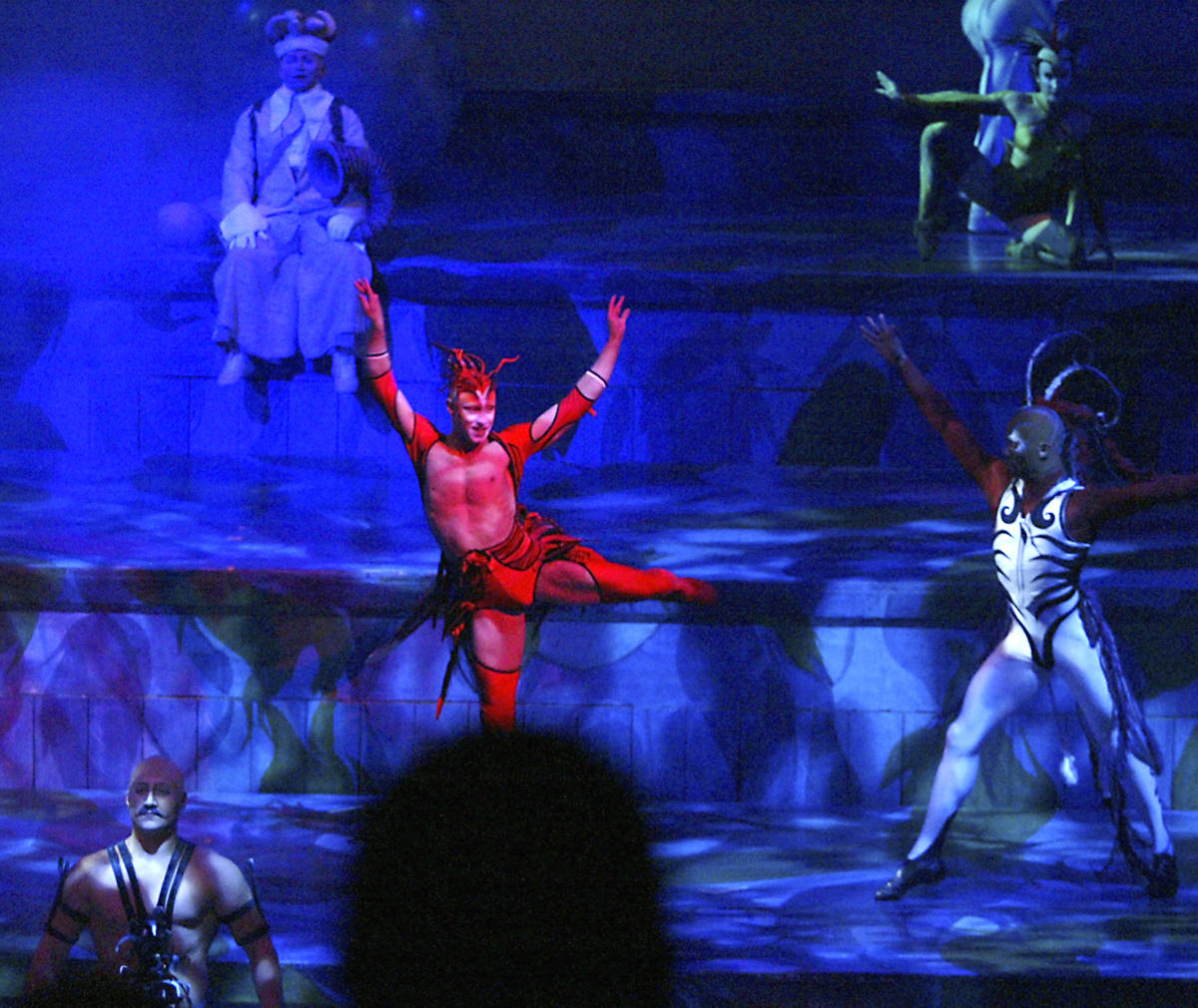 """Cast members perform during the Cirque du Soleil """"Mystere"""" show in the Mystere Theater at Treas ..."""