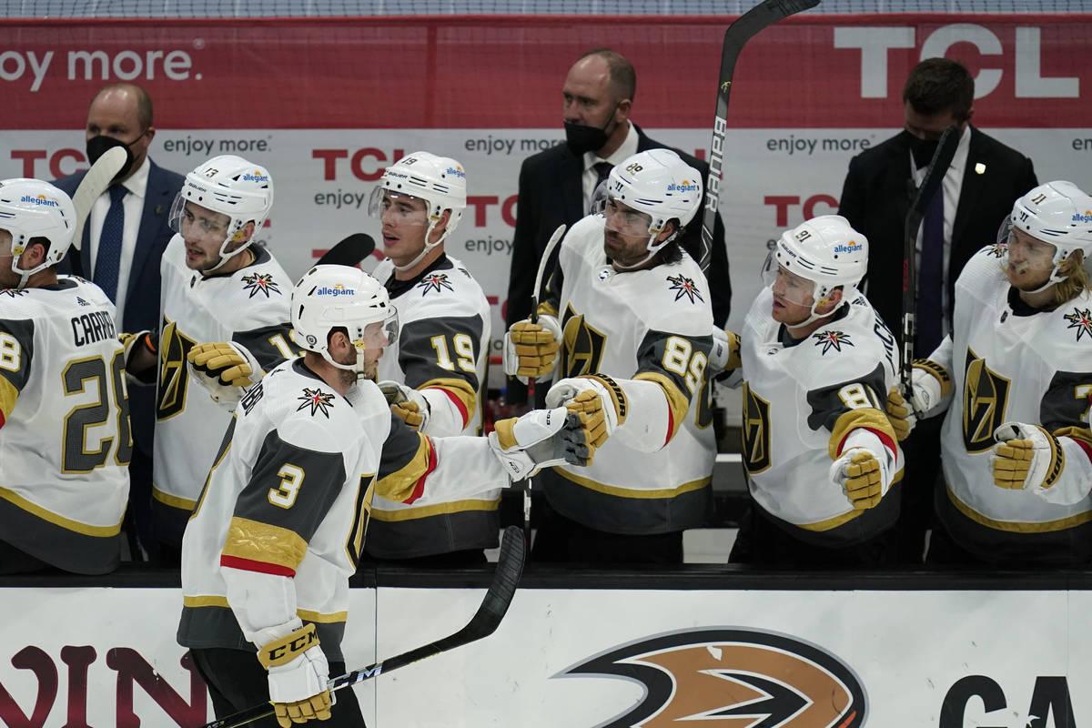 Vegas Golden Knights defenseman Brayden McNabb (3) celebrates with teammates after he scored a ...