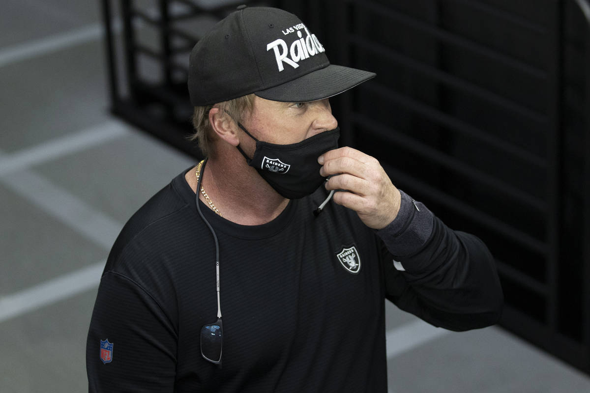 Raiders head coach Jon Gruden takes the field during warm ups before the start of an NFL footba ...