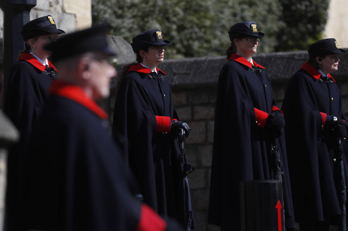 Wardens and armed police guard the Henry VIII gate in Windsor, England, Friday, April 16, 2021. ...