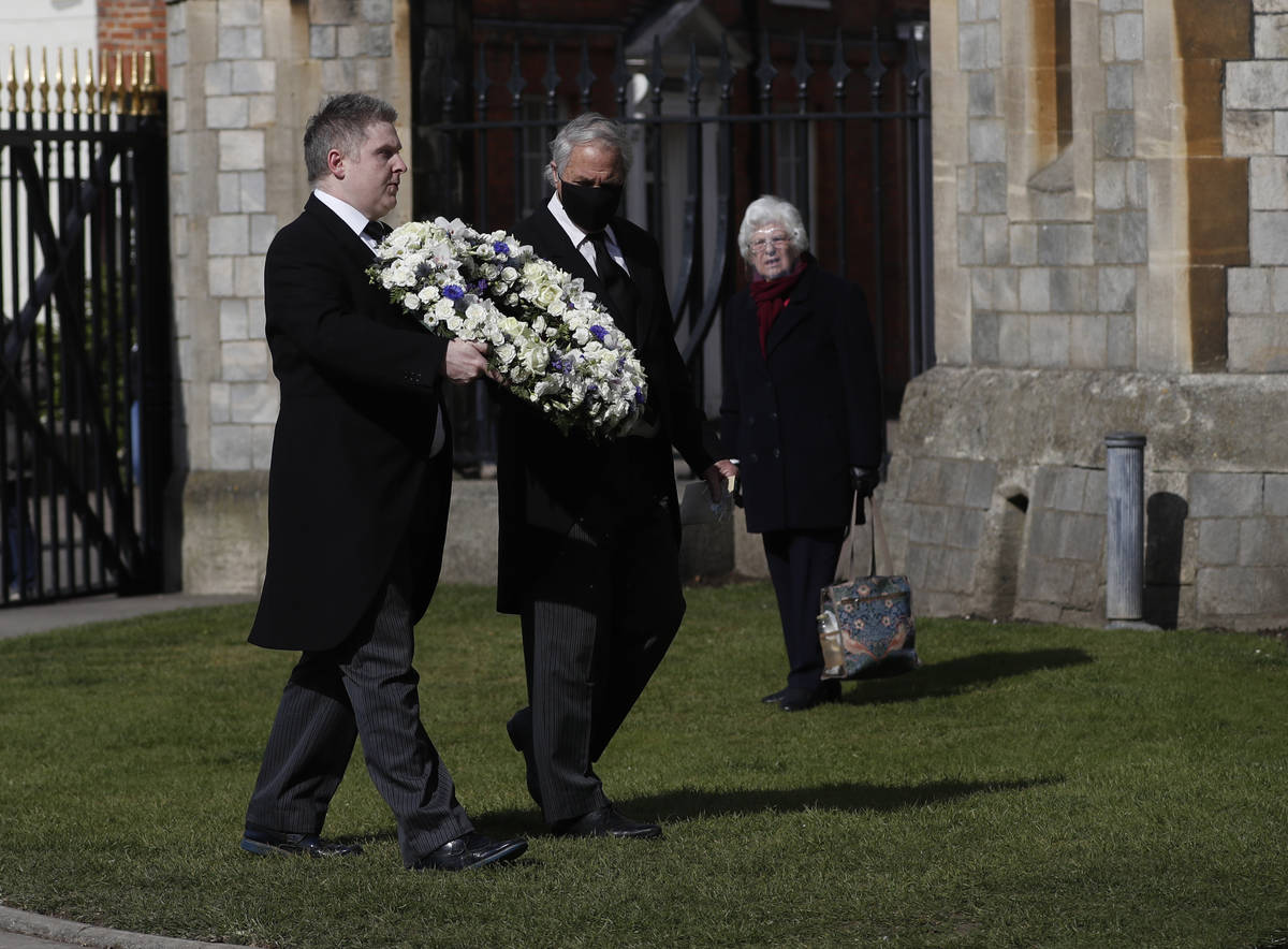 Andre and Stan Walker lay a floral wreath for Prince Philip outside Windsor Castle in Windsor, ...