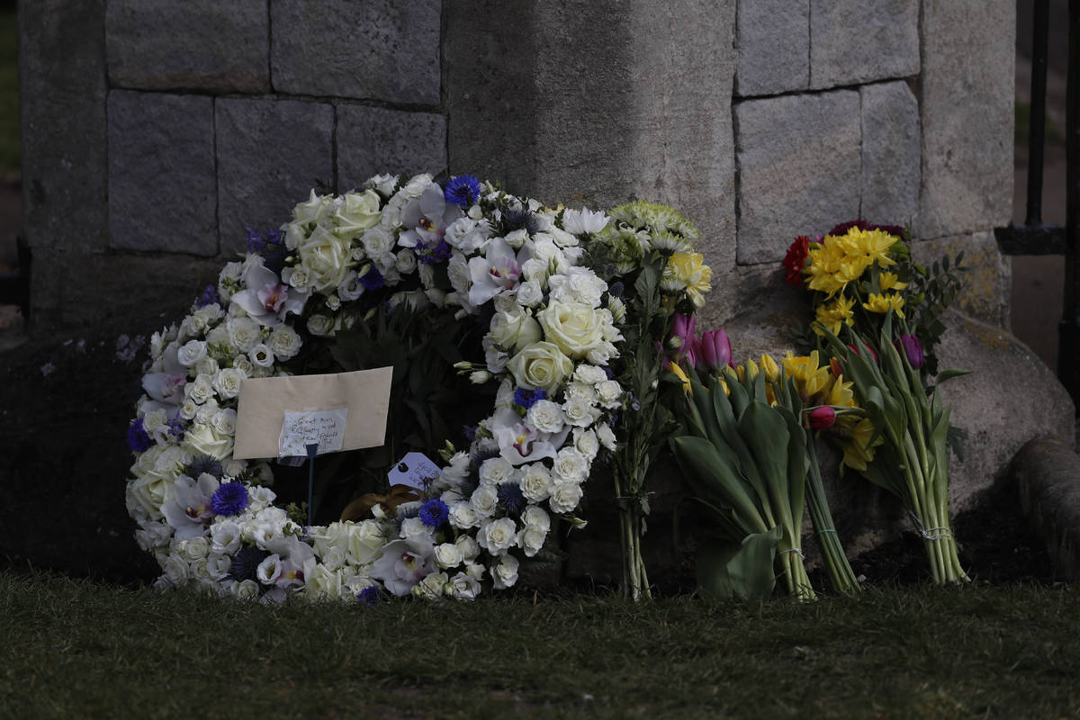 A wreath laid by Andre and Stan Walker for Prince Philip outside Windsor Castle in Windsor, Eng ...