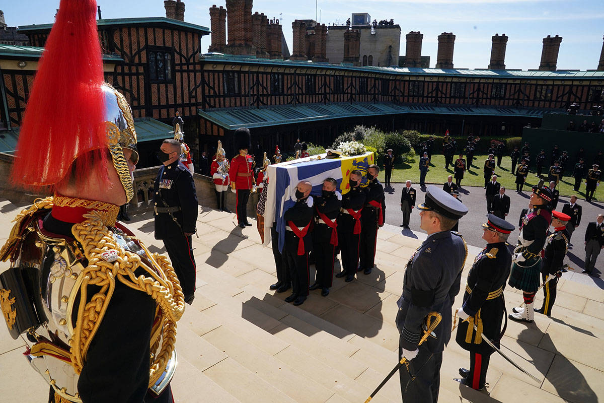 The coffin is held on the steps of St George's Chapel during the procession of Britain Prince P ...