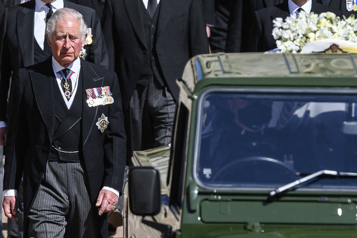 Britain's Prince Charles follows the coffin as it makes it's way past the Round Tower during th ...