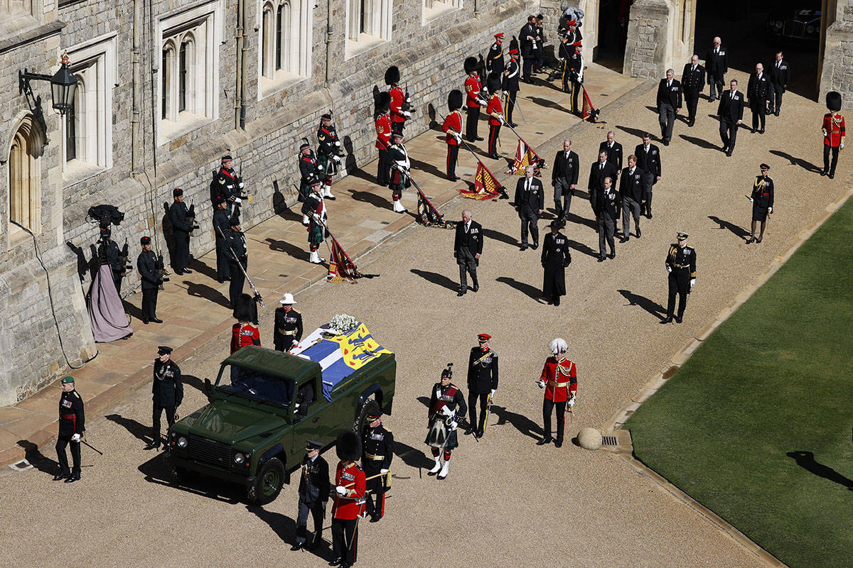 Members of the Royal family follow the coffin of Britain's Prince Philip in the Quadrangle at W ...