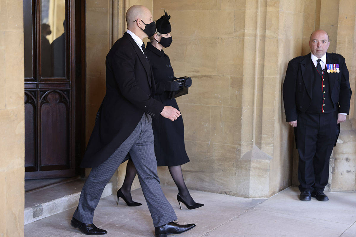 Zara Tindall, center, and Mike Tindall attend the funeral of Britain's Prince Philip inside Win ...
