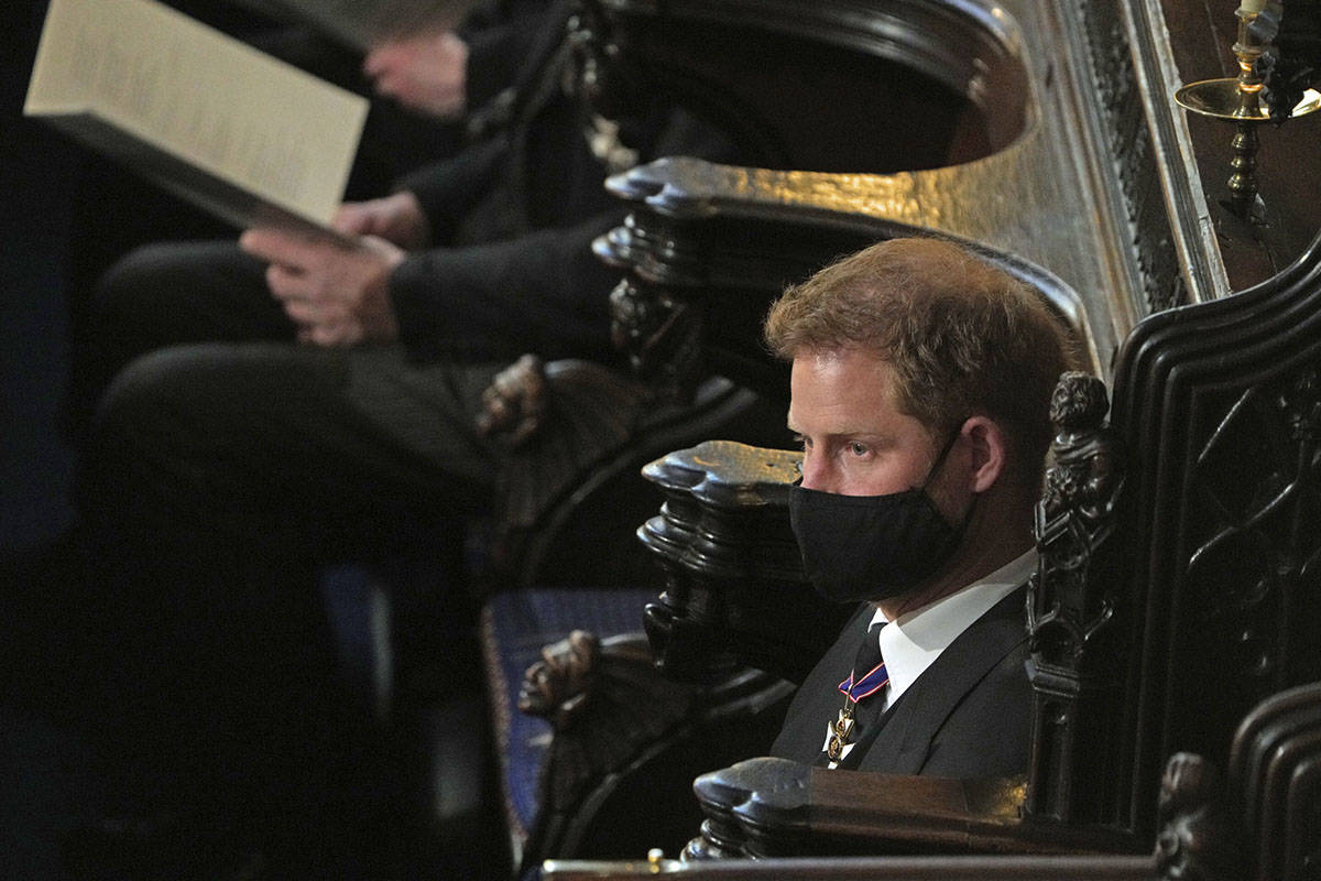 Prince Harry sits alone at St. George's Chapel during the funeral of Prince Philip, at W ...