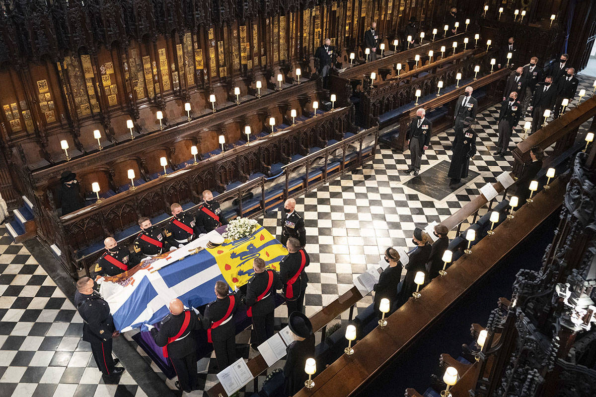 Queen Elizabeth watches as pallbearers carry the coffin of the Duke of Edinburgh during his fun ...