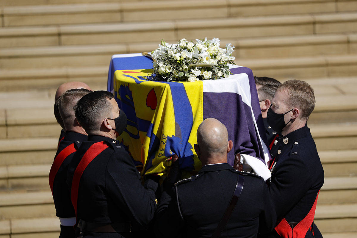 The coffin arrives at St George's Chapel for the funeral of Britain's Prince Philip inside Wind ...