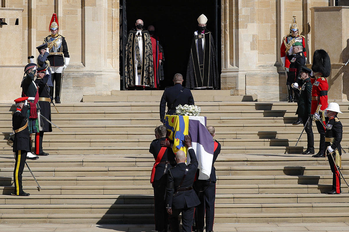 The coffin is carried inside the St George's Chapel for the funeral of Britain's Prince Philip ...