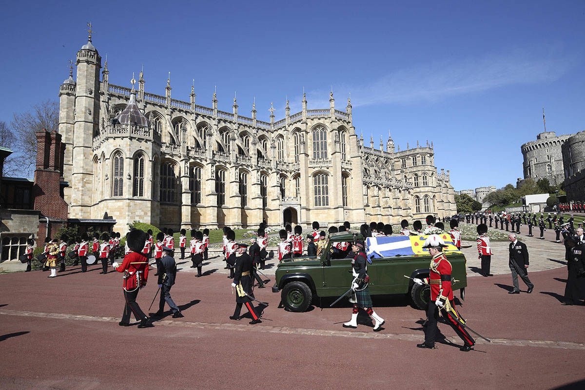 The coffin slowly makes its way in a ceremonial procession during the funeral of Britain's Prin ...