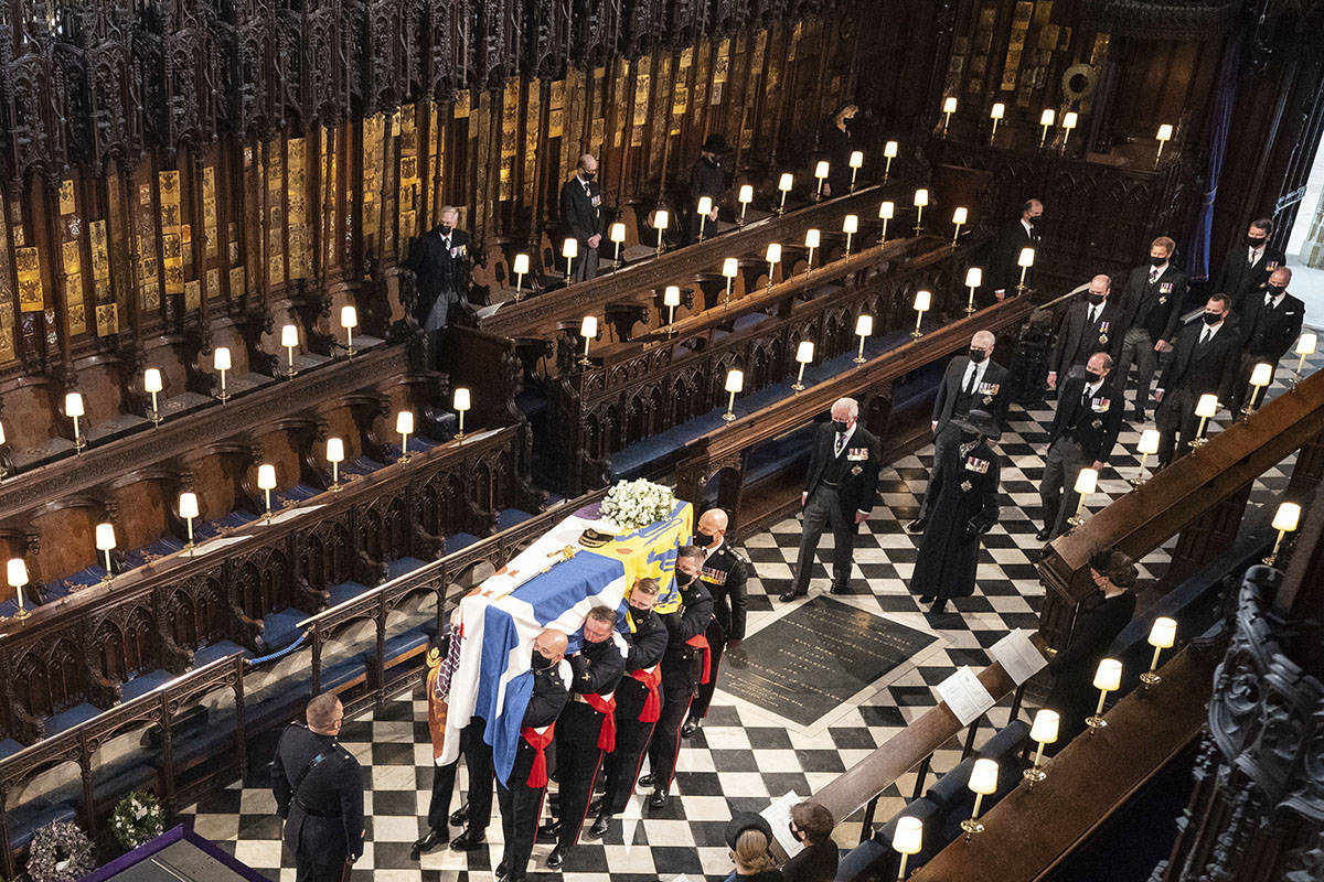 Pallbearers carry the coffin of the Duke of Edinburgh during his funeral, at St George's Chapel ...