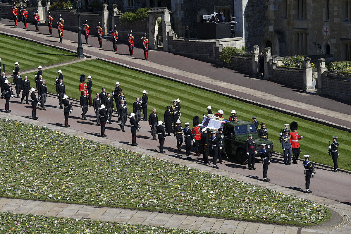 The coffin is carried on a Land Rover during the procession for the funeral of Britain's Prince ...