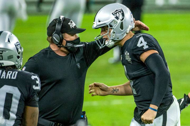 Raiders head coach Jon Gruden comes together on the sidelines with Raiders quarterback Derek Ca ...