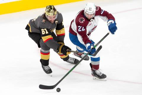 Golden Knights right wing Mark Stone (61) and Colorado Avalanche defenseman Conor Timmins (22) ...