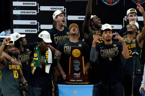 Baylor players celebrate with the trophy after the championship game against Gonzaga in the men ...