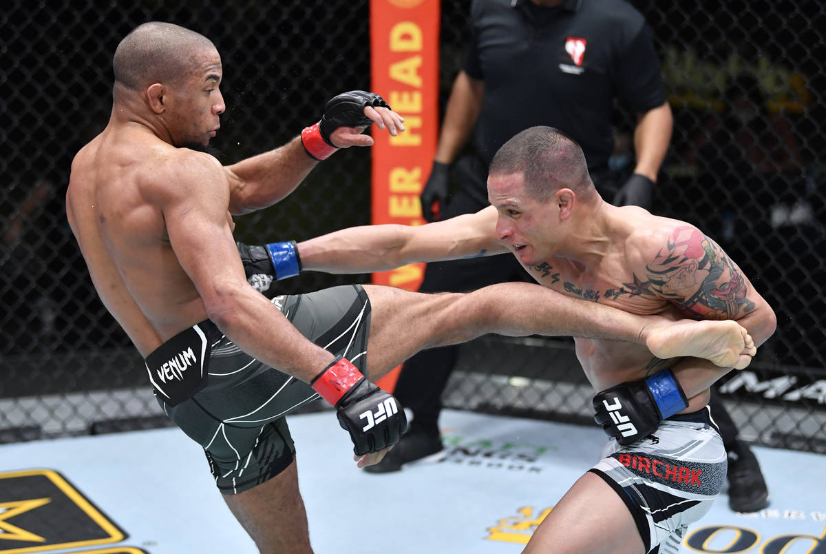 Tony Gravely and Anthony Birchak trade strikes in a bantamweight fight during the UFC Fight Nig ...