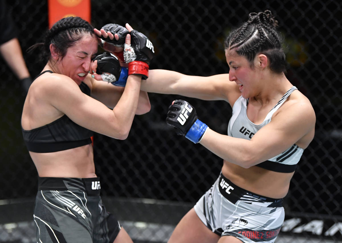 Loopy Godinez of Mexico punches Jessica Penne in a strawweight fight during the UFC Fight Night ...