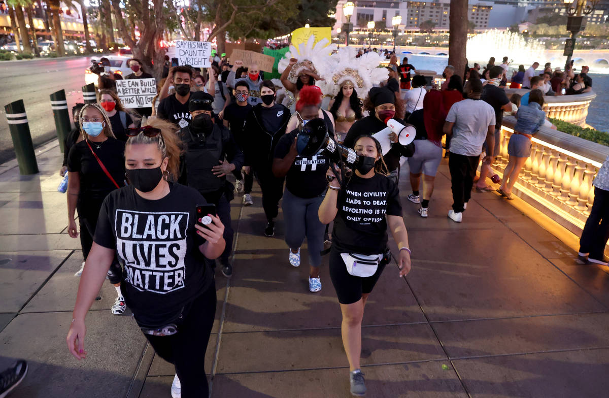 Protesters, including Leinati Hackley,, left, and Desiree Smith,of More Than A Hashtag, march a ...