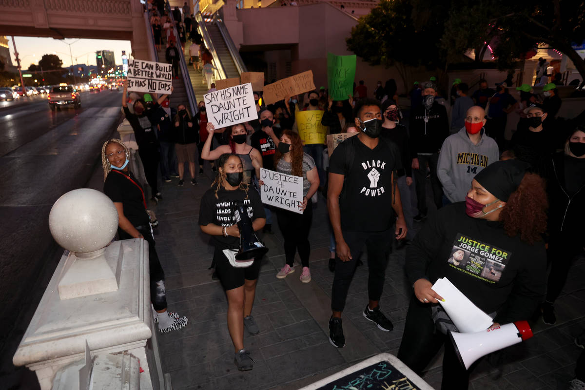 People protest on the Strip in Las Vegas Saturday, April 17, 2021, following the fatal police s ...