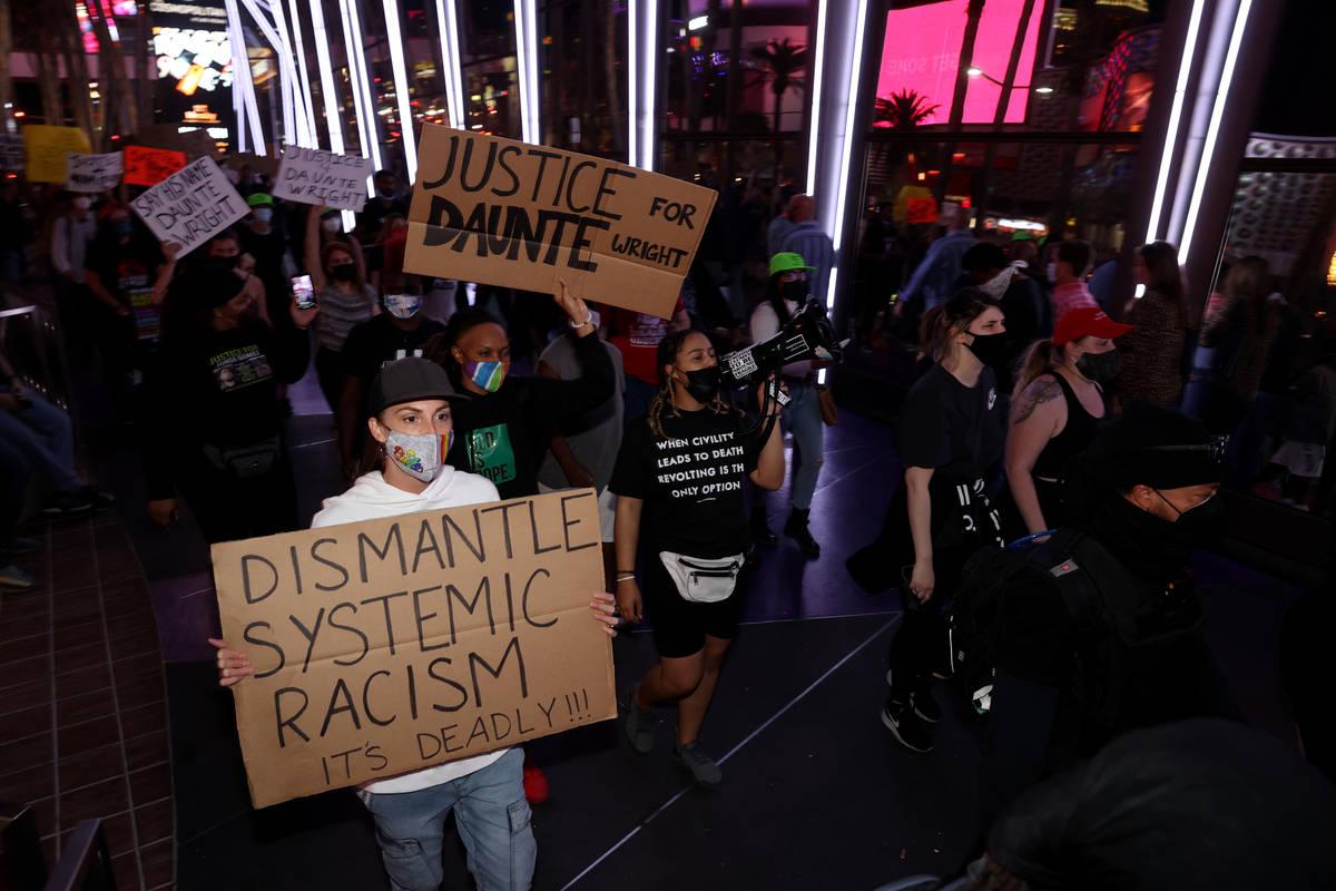 Protesters, including Maria Hayden of Las Vegas, left, march near the The Cosmopolitan of Las V ...