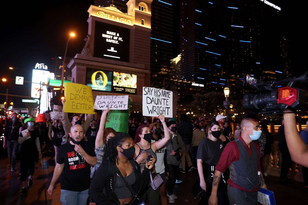 People protest at the Bellagio on the Strip in Las Vegas Saturday, April 17, 2021, following th ...