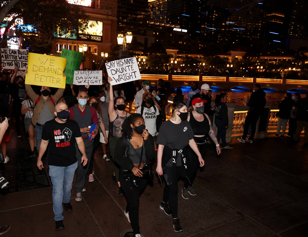 People protest at the Fountains of Bellagio on the Strip in Las Vegas Saturday, April 17, 2021, ...
