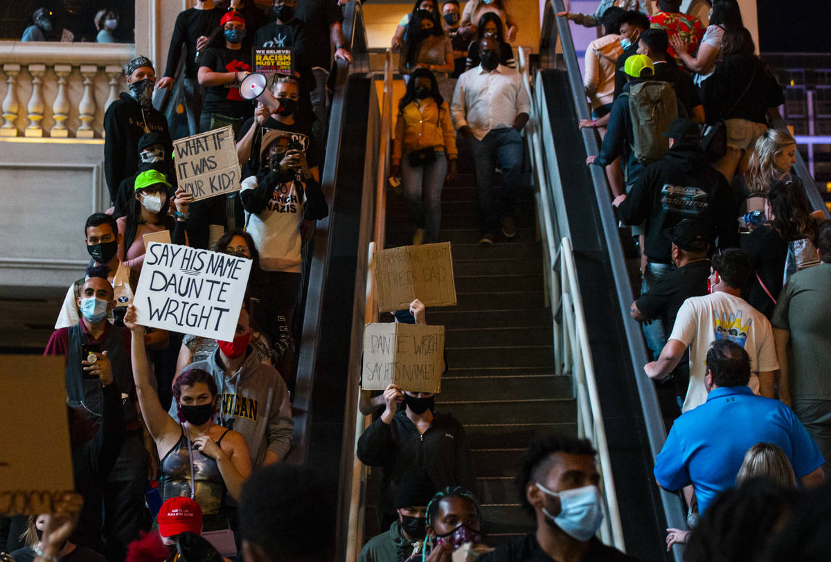 People participate in a demonstration in solidarity with the families of Daunte Wright and Adam ...