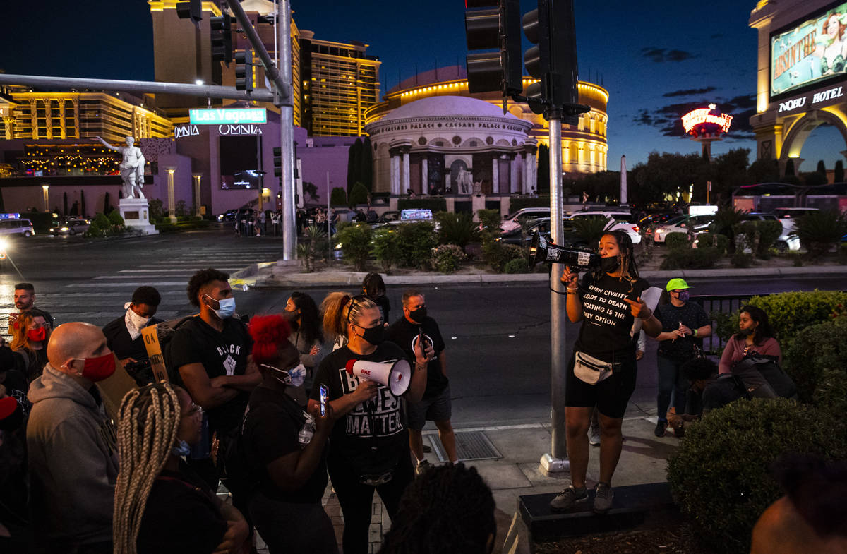 Desiree Smith, founder of More Than A Hashtag, center, speaks during a demonstration in solidar ...