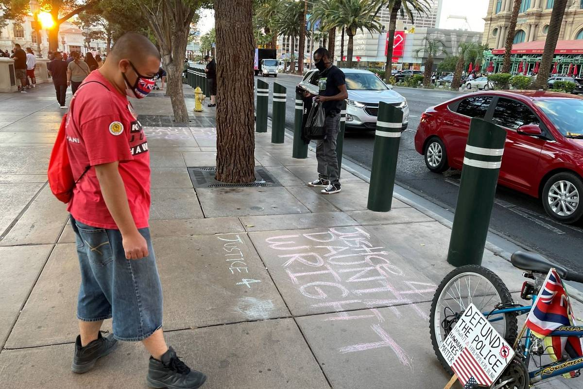 Protesters gather in front of the Fountains of Bellagio on the Las Vegas Strip on Saturday, Apr ...