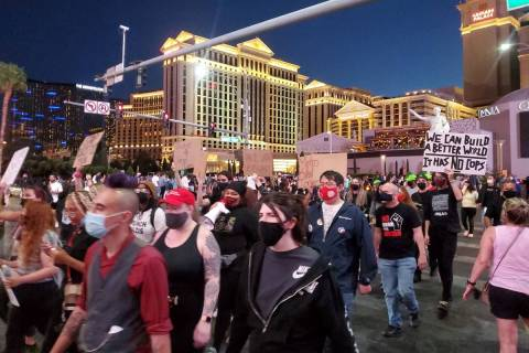 Protesters march on the Las Vegas Strip on Saturday, April 17, 2021. (Chase Stevens/Las Vegas R ...