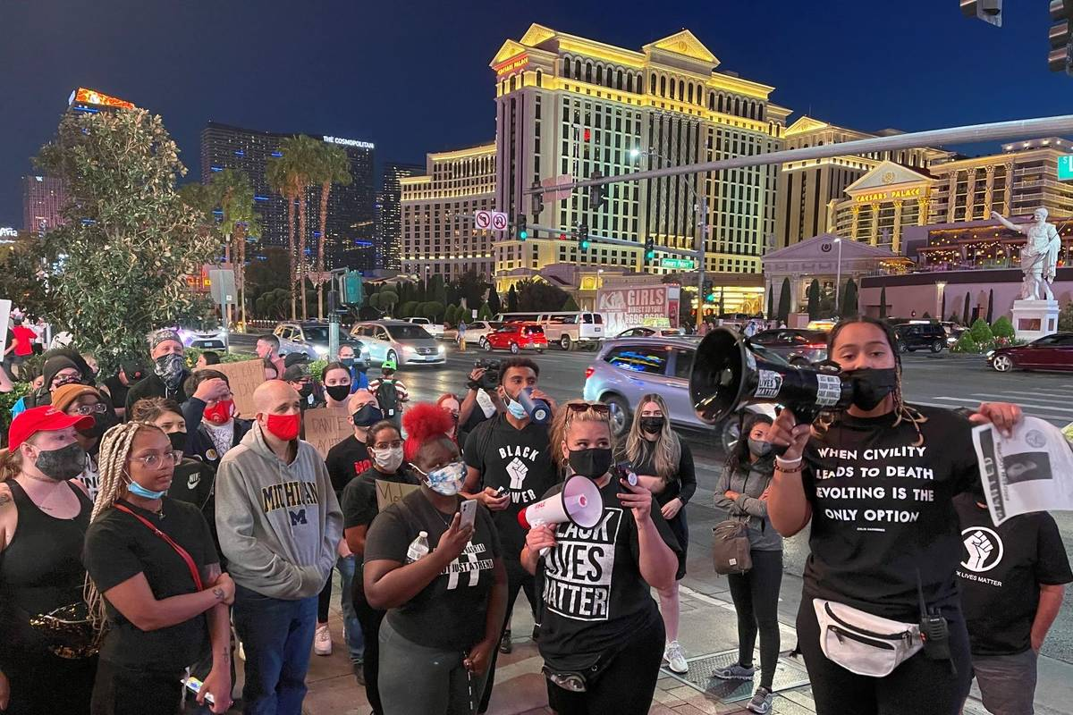 Protesters march on the Las Vegas Strip on Saturday, April 17, 2021. (Kevin Cannon/Las Vegas Re ...