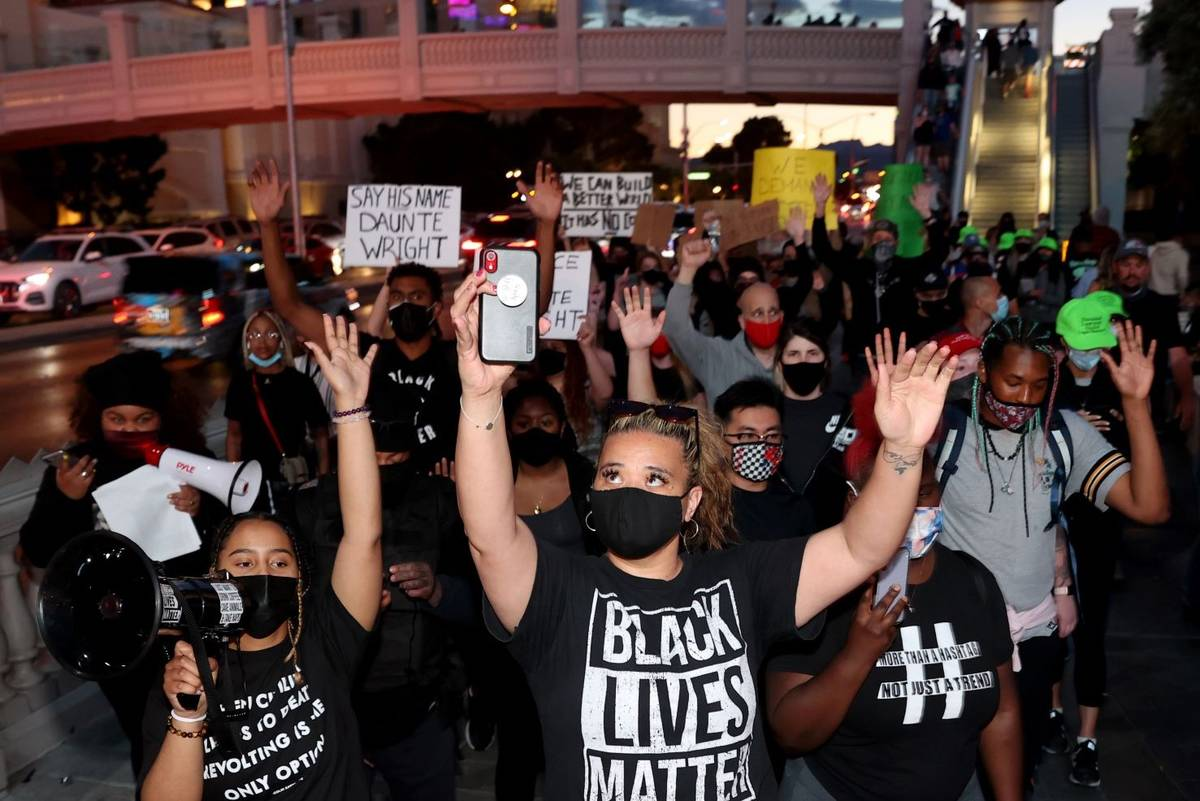 Protesters, including Desiree Smith, left, and Leinati Hackley, of More Than A Hashtag, march a ...