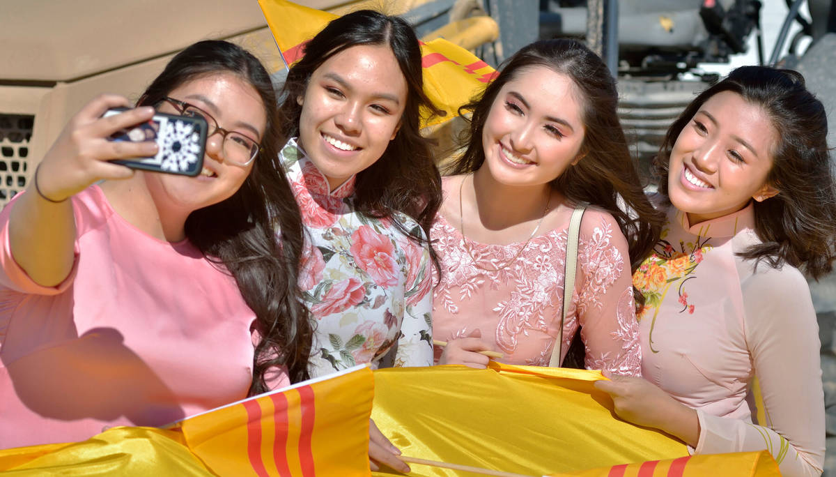 Kim Tran, 17, left, takes a picture with, from left, Kala Nguyen, 17, Jennele Nguyen, 17, and A ...