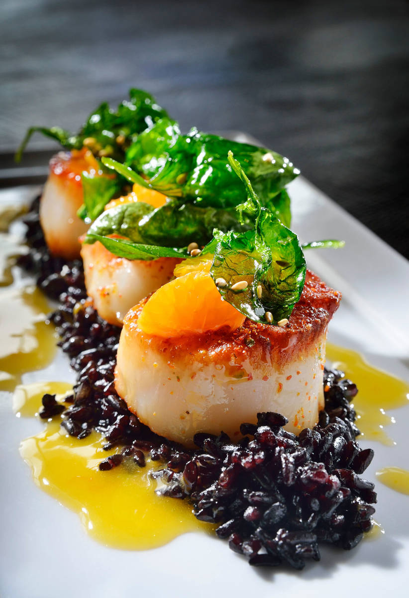 The Pan-seared Sea Scallops with Black Forbidden Rice is shown at Koi in the Planet Hollywood h ...
