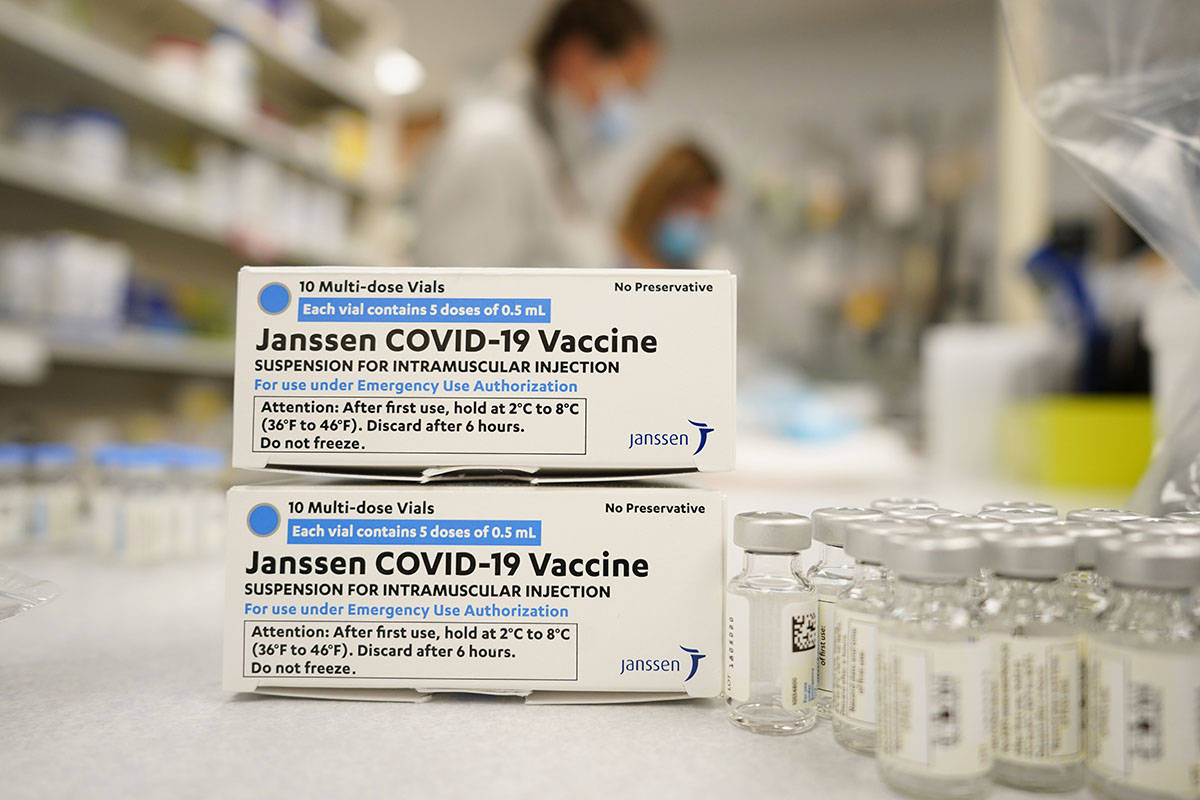 FILE - In this March 6, 2021, file photo, boxes stand next vials of Johnson & Johnson COVID-19 ...