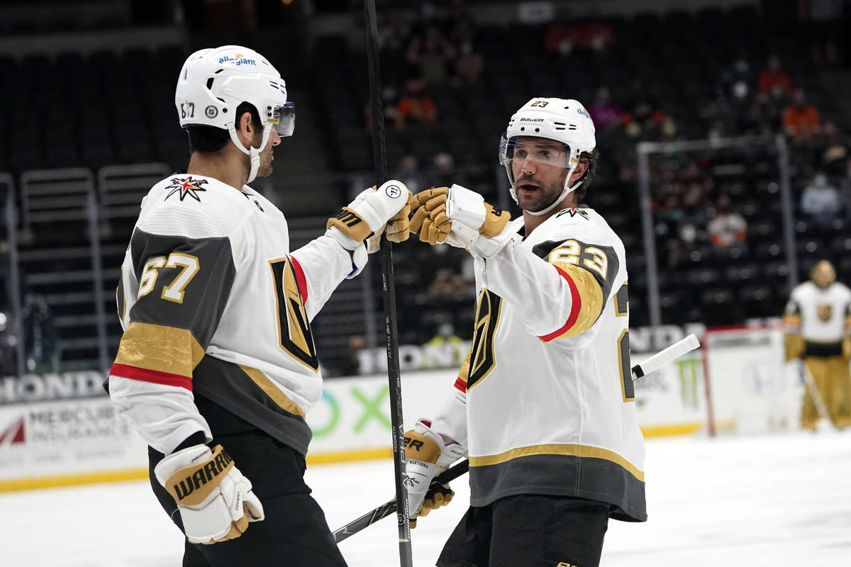 Vegas Golden Knights left wing Max Pacioretty (67) celebrates his goal with Alec Martinez (23) ...