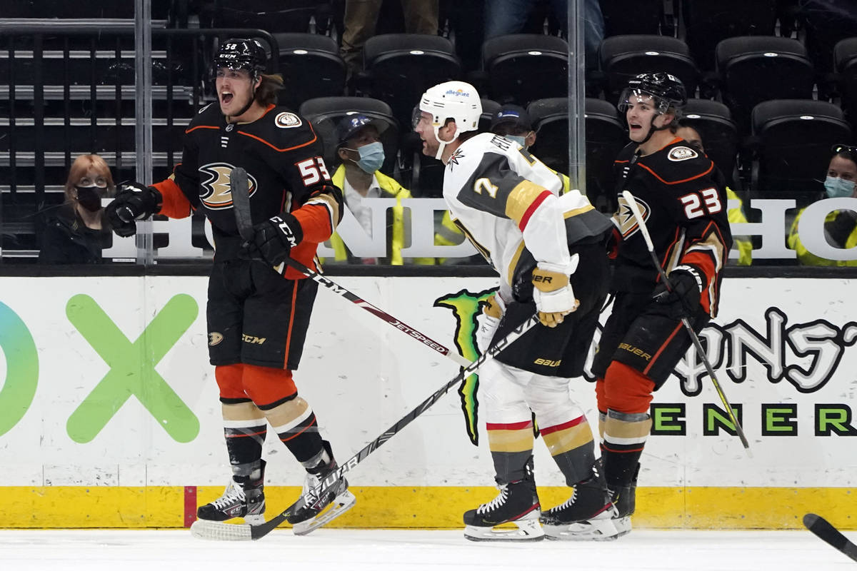 Anaheim Ducks left wing Max Comtois, left, celebrates after scoring during the first period of ...