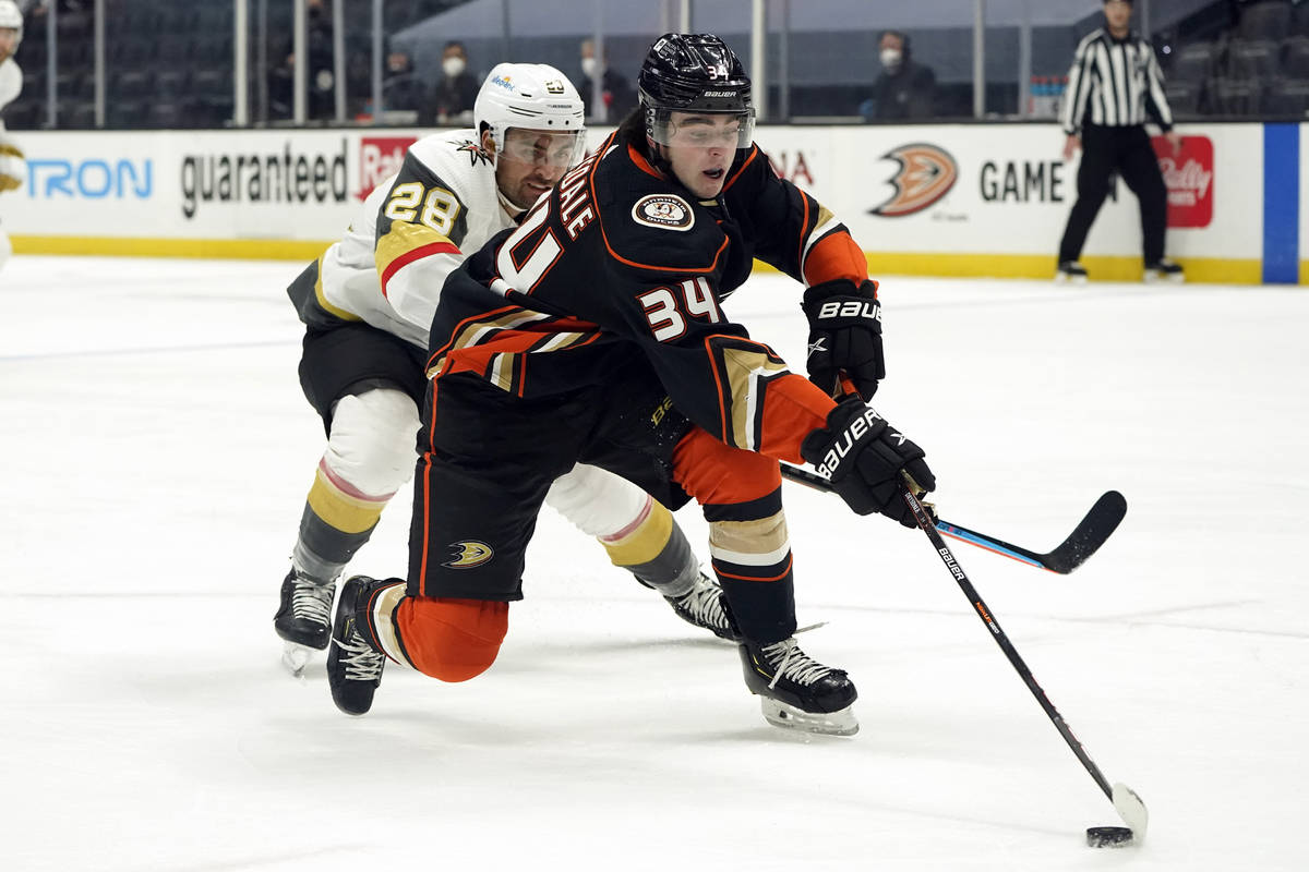 Anaheim Ducks defenseman Jamie Drysdale (34) reaches for the puck in front of Vegas Golden Knig ...